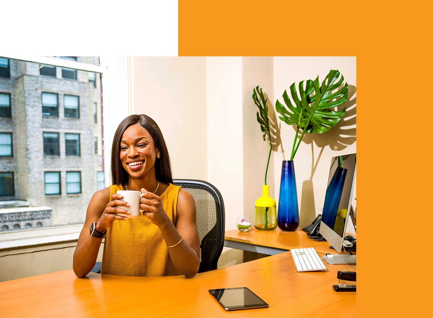 Woman holding a cup in an office